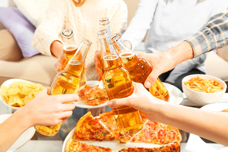 Friendly party with hot pizza and drinks, close up 스톡 콘텐츠