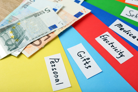 Distribution of money, financial planning, euro and bright envelopes, on wooden table background Stock fotó