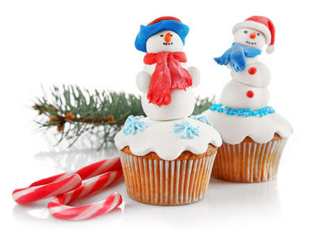 Christmas cupcakes isolated on white