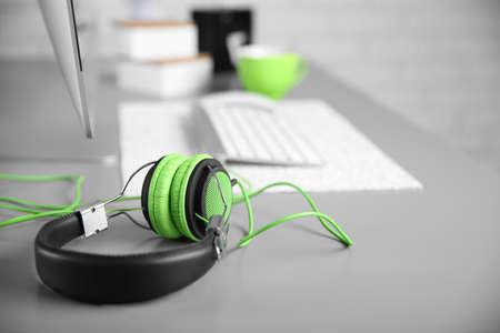 Headphones on gray table against defocused background