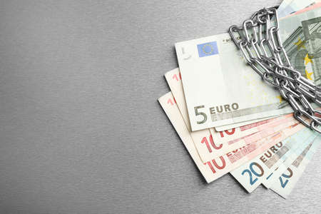 Euro banknotes with lock and chain on gray background Stock fotó