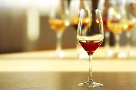 Glass of red wine on a table, close up Stock Photo