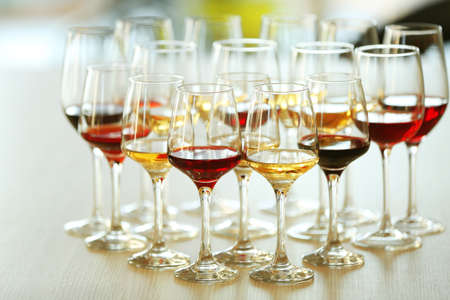 Many glasses of different wine on a table Stock Photo