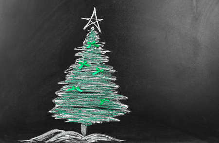 Fir tree drawing on blackboard. Xmas background 写真素材