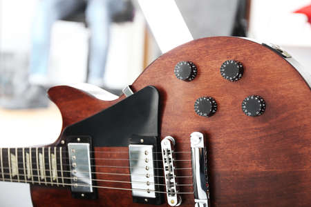 Brown electric guitar, close up