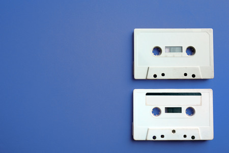 Old audio cassettes on red background Фото со стока