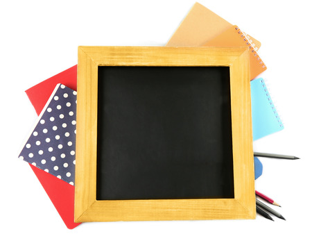 Small school blackboard with stationery isolated on white