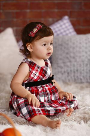 Little girl on the sofa