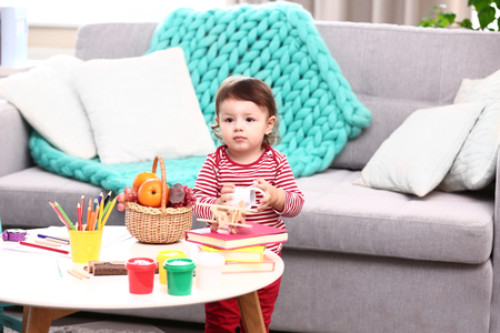 Little girl playing in the room