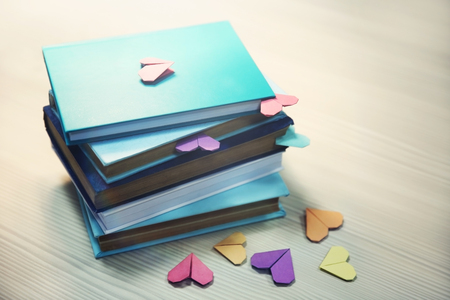 Heart bookmarks for books on wooden table closeup Archivio Fotografico - 104788386