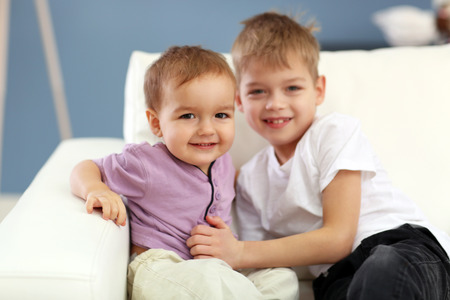 Portrait of cute cheerful brothers in the room