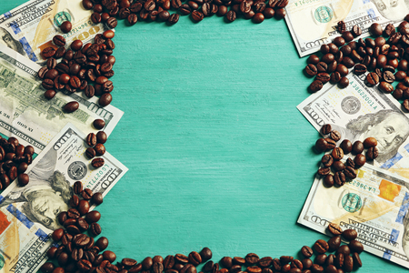 Coffee beans and US dollar banknotes