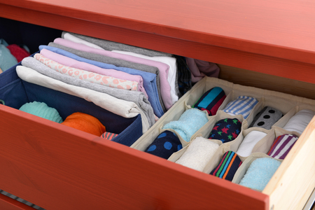 Folded clothes in chest of drawers closeup Archivio Fotografico