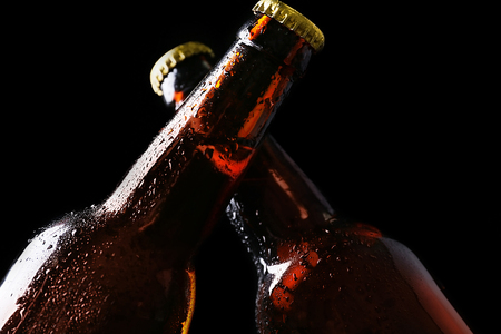 Two glass bottles of beer on black background Stock Photo