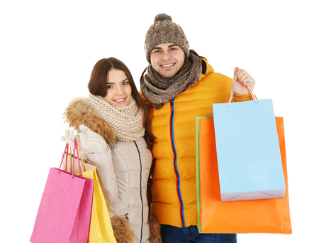 Young couple with colorful shopping bags isolated on white Standard-Bild