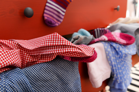 Pile of clothes in open drawer, close up Stock Photo