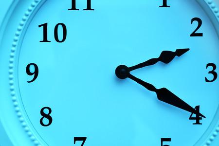 Clock face in blue light closeup