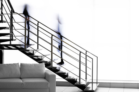 Modern stairs in office and blurred silhouettes of moving people Banque d'images