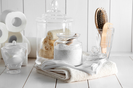 Bath accessories on wooden wall background Stock Photo