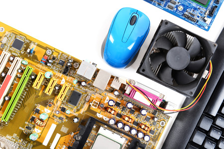 Computer parts with keyboard and mouse on white background