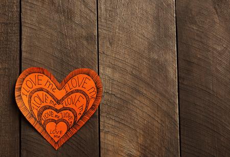 Orange Valentine with inscription on wooden background