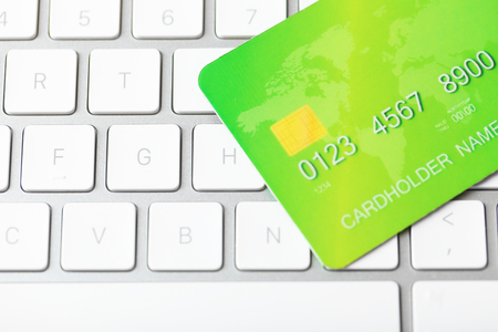 Credit card on keyboard, close up Standard-Bild