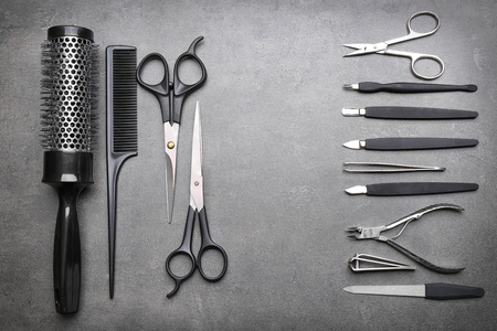 Barber and manicure set on grey background Stock Photo