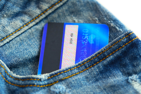 Credit card in pocket of jeans, closeup