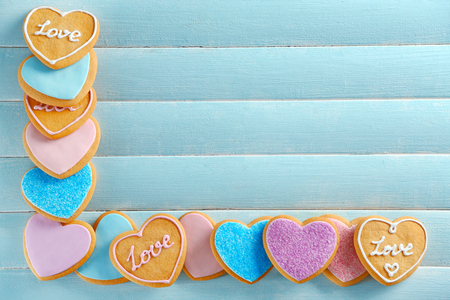 Assortment of love cookies on blue wooden table background, copy space Stock Photo