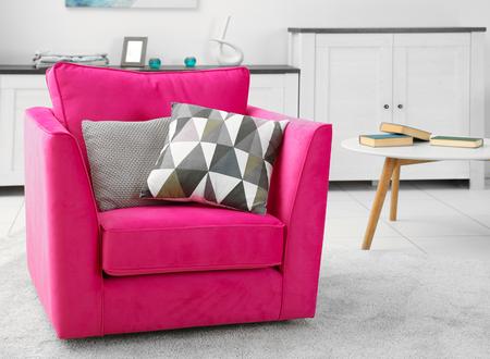 Pink armchair in modern interior of living room Zdjęcie Seryjne
