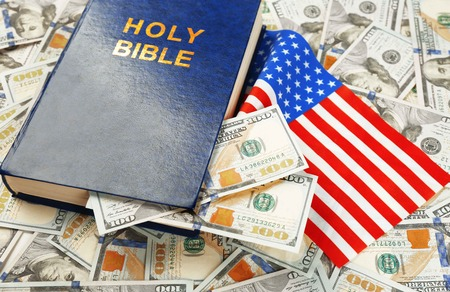 Holy Bible with American flag on money background 版權商用圖片