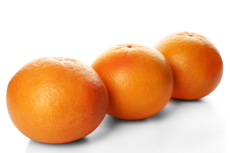 Grapefruits in a row isolated on white background Foto de archivo