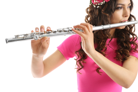 Beautiful young woman with flute isolated on white Standard-Bild