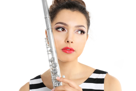 Beautiful young woman with flute isolated on white Stock Photo