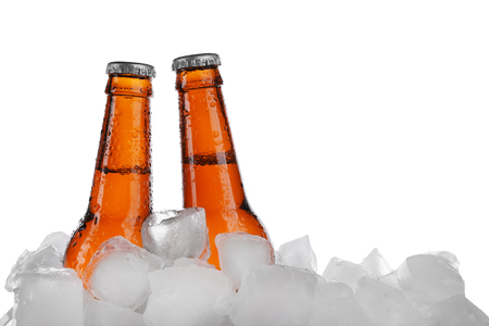 Beer bottles in ice cubes, isolated on white Stock Photo