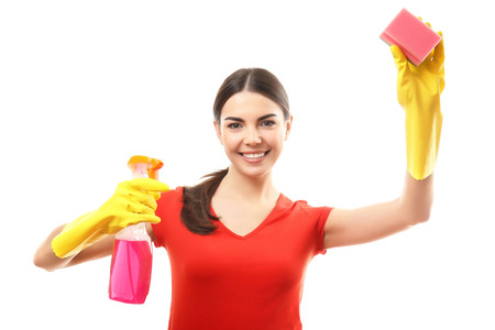 Young woman holding sponge and detergent spray, isolated on white