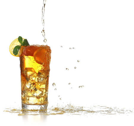 Fresh iced tea pouring in a glass