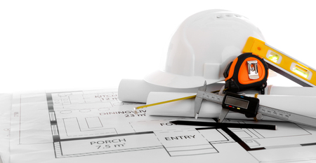 Project drawings and white helmet isolated on white