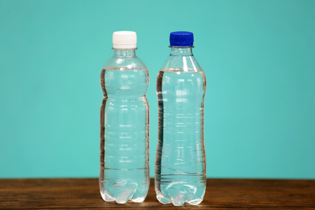 Two bottles of water on the blue background.