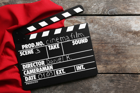 Movie clapper on wooden background