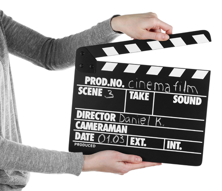 Female hands holding movie clapper isolated on white Stock Photo