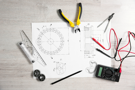 Project drawing and digital multimeter top view Stock Photo
