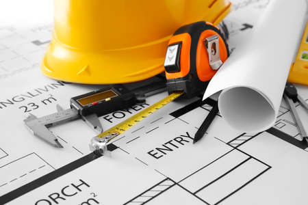 Project drawings and yellow helmet, close up Stock Photo