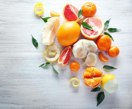 Fresh citrus fruits on a white background
