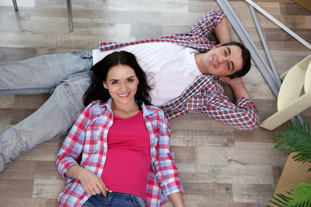 Young couple moving in new house. Top view. Stock Photo