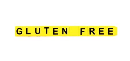 Phrase GLUTEN FREE made of yellow cubes isolated on white Foto de archivo