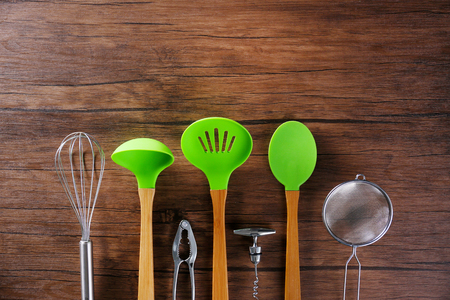 Set of kitchen tools on wooden table