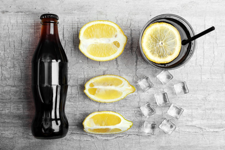 Fresh cocktail preparation:soda bottle,ice, lemons and glass