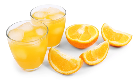 Iced orange drink with fresh pieces isolated on white