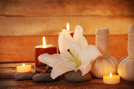 Spa set with lighted candles on wooden background Stock Photo